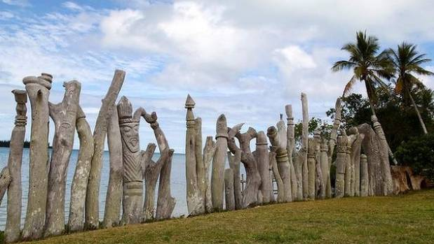 Carved totem poles near Saint Maurice Beach, Isle of Pines.
