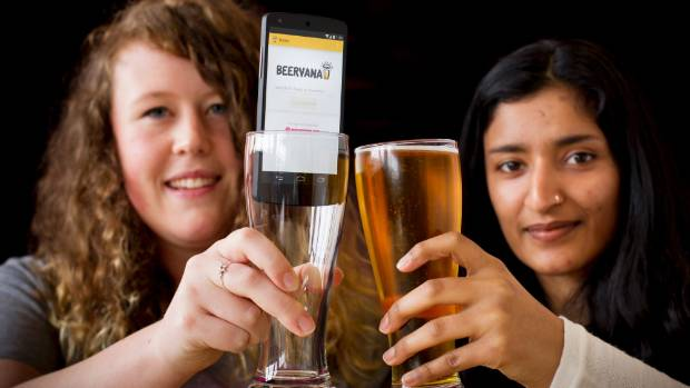 Josianne Hyson, left, and Pragya Mohan with their Beervana beer info App.