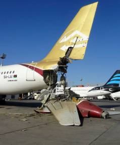 WINGED: A damaged aircraft is pictured after shelling at Tripoli International Airport at the weekend.