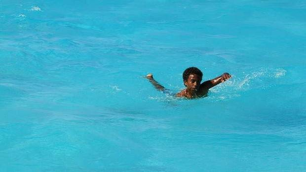 WARM: A local boy swims in Normea.