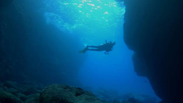 Pam LeBlanc dives off the coast of the Big Island of Hawaii during a live-aboard dive trip on the Kona Aggressor II.