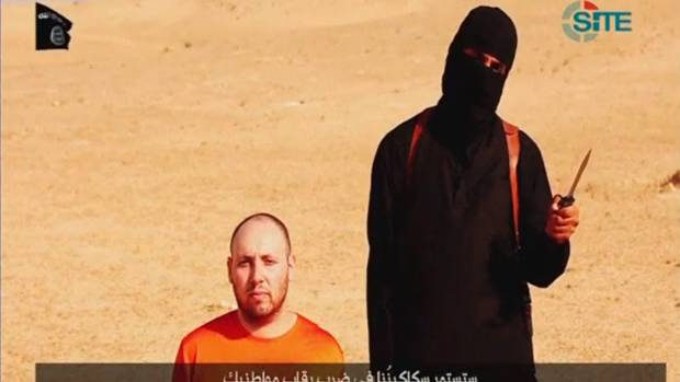 DESPICABLE: A masked Islamic State fighter holds a knife before slaying US journalist Steven Sotloff in this screengrab from an online video.