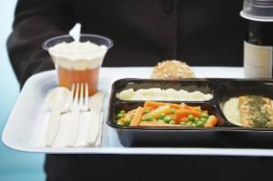 Kiwis love passing the time on long-haul flights by chowing down on plane food.