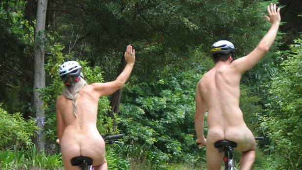 WORLD NAKED BIKE RIDE 2010: As this pair shows, helmets are important even if clothes are not.