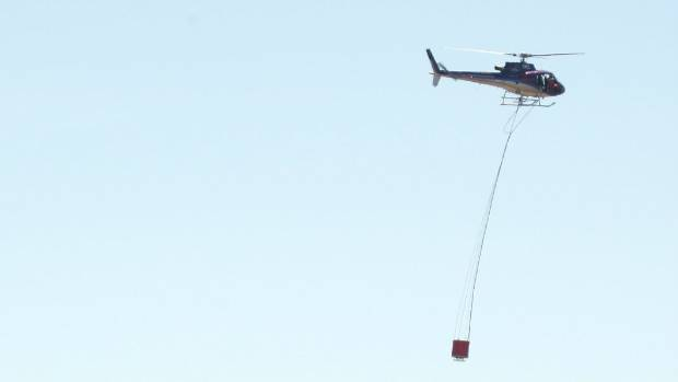 Multiple helicopters with monsoon buckets were used to battle scrub fire in Northland.