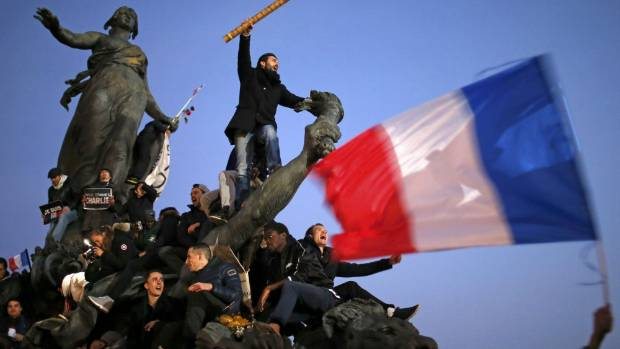 UNIVERSAL RIGHT: A man holds a giant pencil as he takes part in a French citizens solidarity march (Marche Republicaine) ...