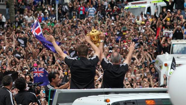 CUP RUNNETH OVER: Captain Richie McCaw (left) and coach Graham Henry hold the William Webb Ellis trophy aloft during the All Blacks' victory parade in Christchurch in 2011.