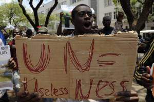 A demonstrator protests against UN peacekeeping troops in Congo in 2012 for failing to protect civilians from rebel fighting.