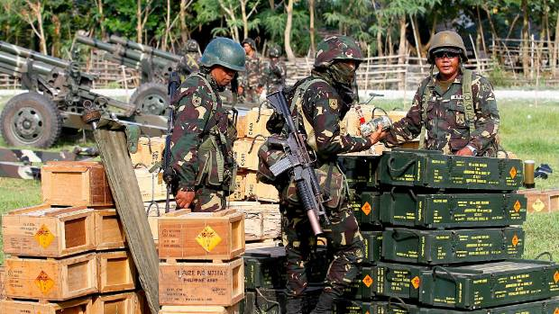Philippine soldiers check ammunition during an offensive operation against the Bangsamoro Islamic Freedom Fighters.