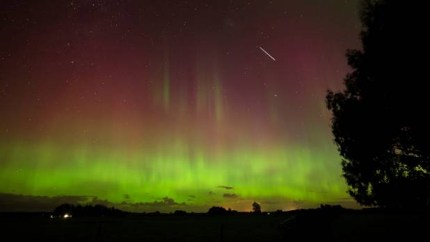 Reader Eddie Griffiths sent in this shot of the Aurora Australis and the International Space Station as seen from ...