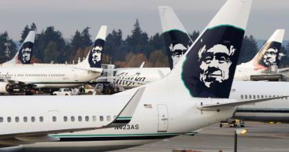 Pay it forward': A kind gesture from an Alaska Airlines employee has helped a stranded passenger fly home.