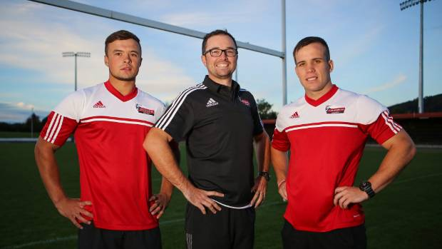 Crusaders Academy coordinator Chris Goodman, centre, with players Curtis Pedersen-Line, left and Fletcher Matthews at Trafalgar Park.