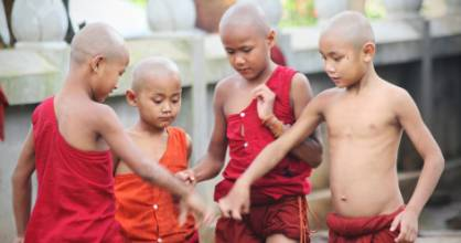 Novice Buddhist monks play tag in Pankam in Myanmar's hill country.