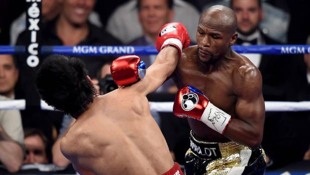 Floyd Mayweather Jr. throws a right hand at Manny Pacquiao during their fight at the MGM Grand in Las Vegas.