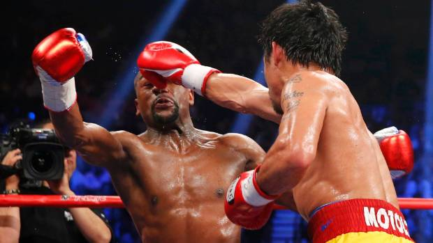 Manny Pacquiao gets through Floyd Mayweather's tight defensive guard to land a big right hand.