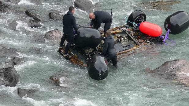 Divers attached floats to the salvage car wreck in Blue Cod Bay near Curio Bay during the recovery.