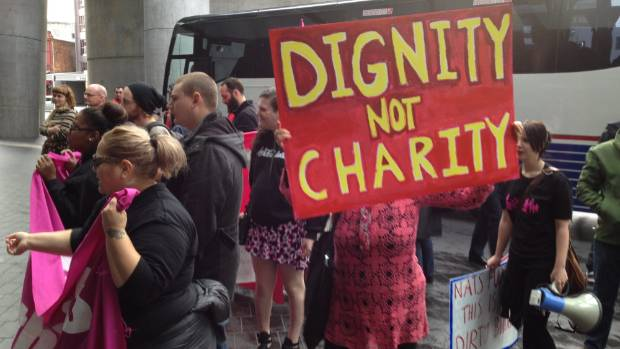 Protesters outside John Key's post-Budget speech in Auckland.