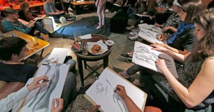 A model poses during a life drawing class at The Lion pub in London.