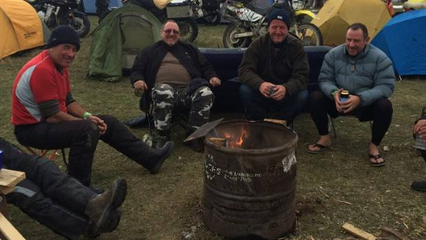 Gathering around a fire are Tommy Jack of Christchurch; Lee Mckernan of Nelson; Wayne Stocks of Christchurch and Morrie Stoddard.