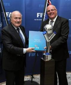 Former NZ Football chief executive Michael Glading (right) joked about handing over envelopes of cash after shaking hands with Fifa president Sepp Blatter.