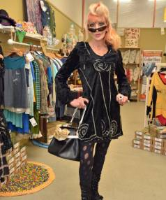 Wainuiomata upcycled fashion designer Zorro Potion, models one of her Ghost Train label dresses, and a handbag she made using a tyre inner tube.  She is in the Eco Fashion Week pop-up shop in Petone.