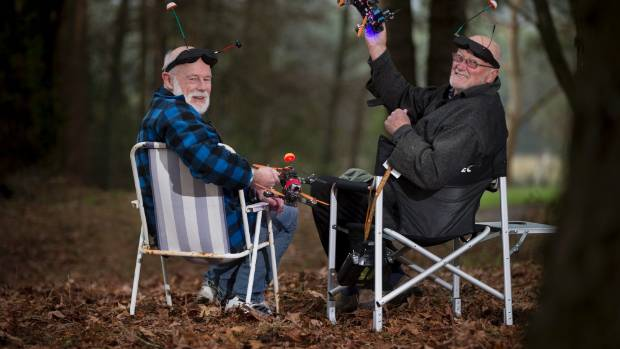 Drone racers Bruce Simpson, left,  and Gordon Hudson with their drones, POV video goggles and deck chairs are all ready for a bit racing in a forest area near Tokoroa.