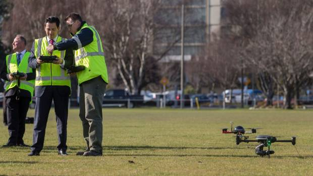 Minister for Transport, Simon Bridges and his Associate Minister, Craig Foss, left, prepare to fly a drone at the University of Canterbury's Ilam Fields on Monday following the announcement of new Civil Aviation Authority regulations governing Unmanned Aerial Vehicles (UAV). Bridges is receiving pre-flight instructions from Nick Key from the University's geography department.