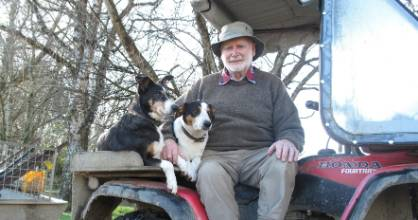 Malcolm Mackenzie with dogs Tess and Belle on his farm, near Browns. Mackenzie is nominated for a Southland Environment Award for farming.