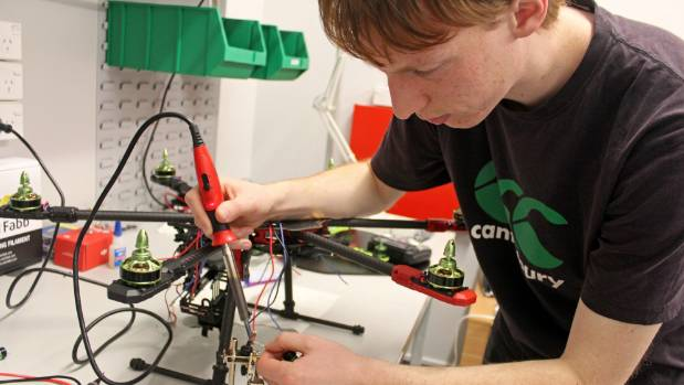 Seamus Rowe soldering together parts of the drone.
