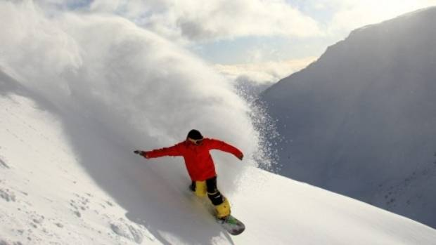 Fresh powder lures a snowboarder at The Remarkables ski field in Queenstown.