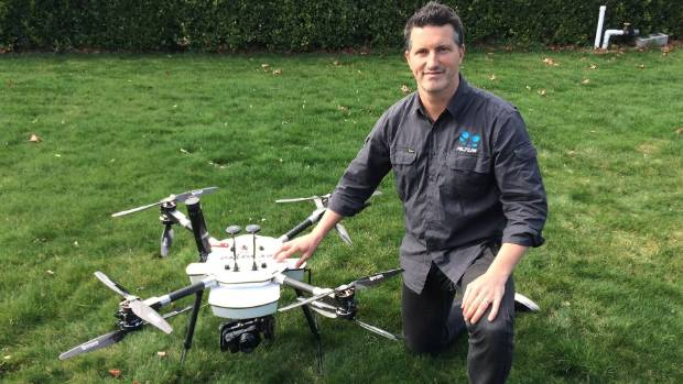 Altus business development manager Simon Morris with the company's Delta X8 drone.