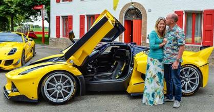 Google executive Benjamin Sloss kisses his wife, Christine, in front of his birthday present for her, a Ferrari FXX K supercar.