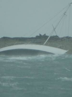 Amanda Solloway was going to check on her partner's boat in Nelson's wild weather when she photographed another vessel being rescued off the Boulder Bank.