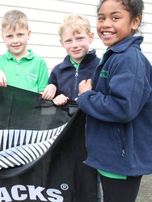 Carterton School pupils, from left, Lyon Rodger, Kayne Allanson, Jeordie Fennell, Harry Russell and Georgie-Leigh Te Rangi are thrilled to be meeting three of the All Blacks.
