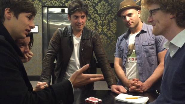 Band of Magicians - Ben Harlin, left, Brett Loudermilk, Adam Mada  and James Galea - astonished reporter Charlie Gates with a card trick.