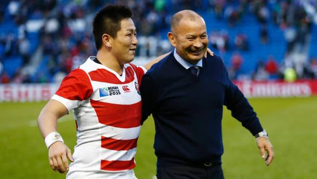 Japan coach Eddie Jones, right, celebrates his team's famous victory over South Africa with Kosei Ono.