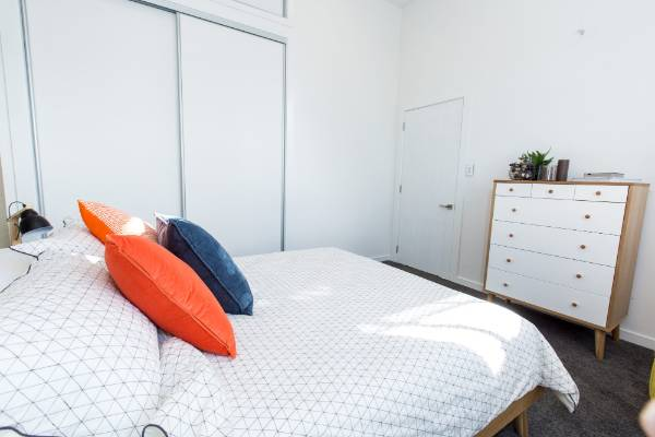 Cushions provided a pop of colour in the bright and airy room.
