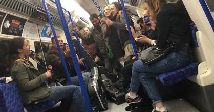 London tube passengers enjoy a mass sing-a-long to the Bill Withers hit, Lean on Me.