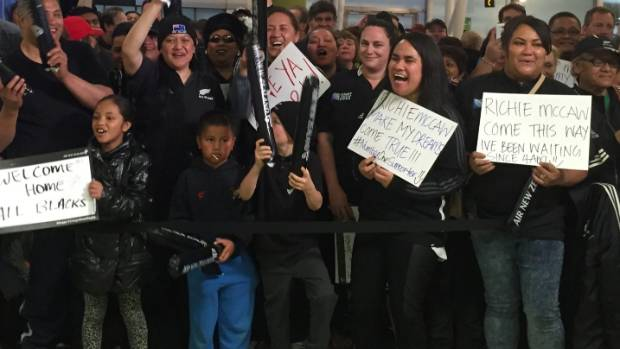 All Blacks fans crowded Auckland airport for the world champions' return home on Wednesday.