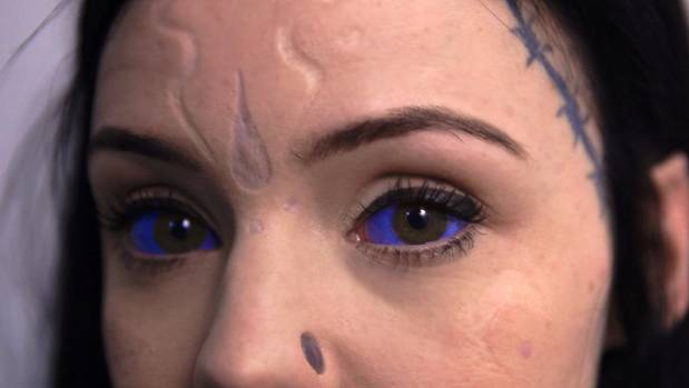 Grace Neutral's face features scarification, ink and tattoos. The purple 'eyeball tattoos' are created with an injection ...