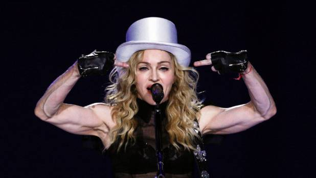 Madonna gestures as she performs during her Sticky and Sweet tour.