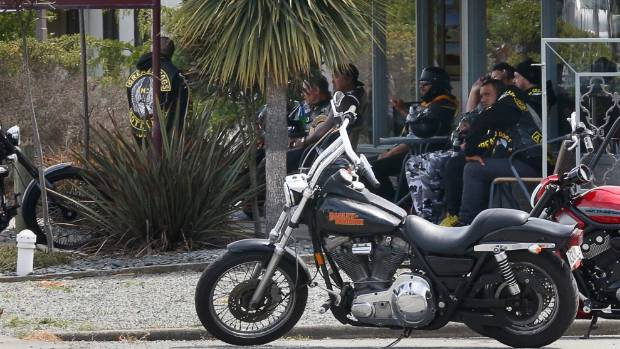 Greasy Dogs members sit outside a cafe in Timaru after they were pulled over by police.