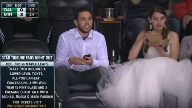 The couple were snapped on the Jumbotron in full bridal wear.
