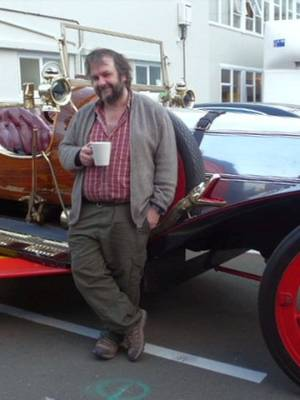 Sir Peter Jackson with Chitty Chitty Bang Bang, an item from his movie collection that will be housed in the new Movie Museum in Wellington.