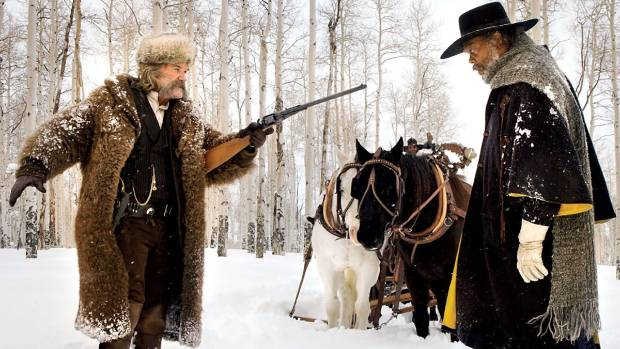 John Ruth (Kurt Russell) the bounty hunter faces off with Major Marquis Warren (Samuel L Jackson) in The Hateful Eight.