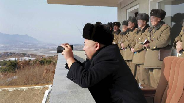 Kim Jong Un watches maneuvers between KPA large combined units 526 and 671 at undisclosed location in this undated photo ...