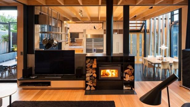 The interior of the Boat Sheds house by SGA with Rachael Rush features a split-level family living space, natural timbers, exposed structural elements and black accents.