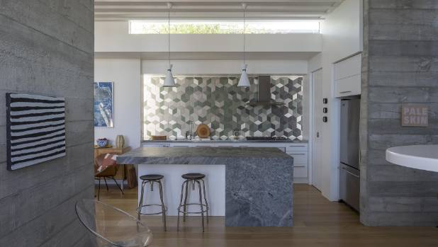 Another NZIA award-winning project, this villa in Grey Lynn was renovated by Xsite Architects. It incorporates board-finished concrete walls on the interior.