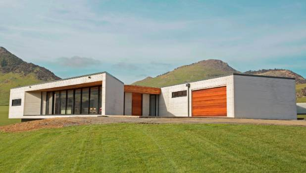 Precast concrete panels with a scored pattern feature on the Grand Designs Caitlins farmhouse designed by Auckland architect Richard Naish.