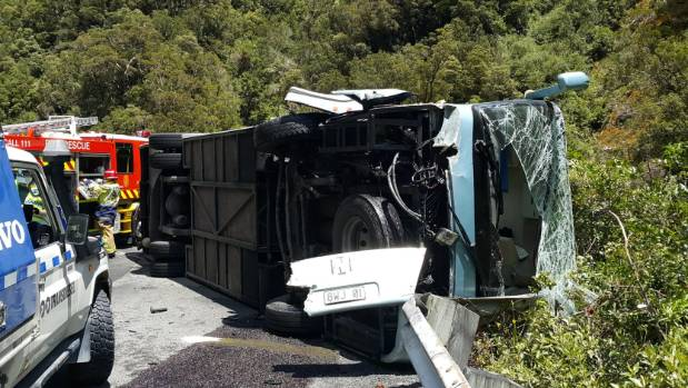 The wreckage of a bus that crashed into a car near Arthur's Pass.
